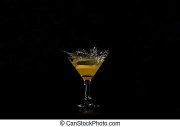 orange dropped into a glass of orange juice