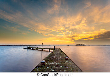Orange dusk over a tranquil lake