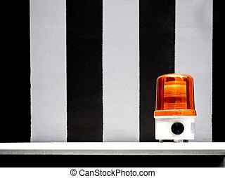 Orange emergency siren light.