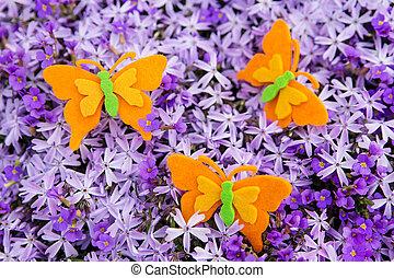 orange felt butterflies with a sea of purple blossoms -...