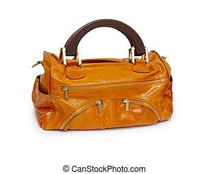Orange female handbag isolated on white background.