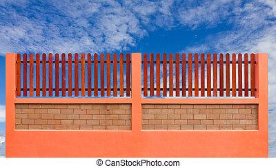 Orange fence and blue sky