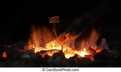 Orange fire in a blacksmith forge flaming to make a wrought...