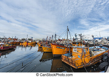 Orange fishing boats in Mar del Plata, Argentina