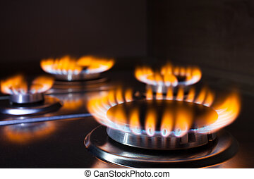 Orange flame at gas stove - Gas burning in the burner of gas...