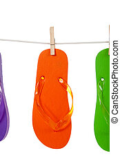 Orange flip - flop on clothesline