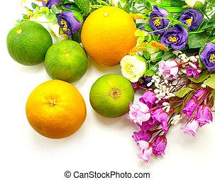 Orange & flowers on a white background