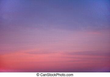 Orange fluffy cloud in a blue sky