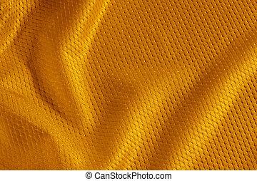 Close up shot of orange textured football jersey