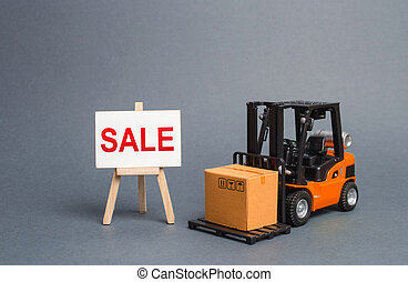 Orange forklift truck carries a cardboard box and a stand with a word sale. growth of sales. big discounts on goods of the outgoing season. commodity exchange with other countries. Attracting buyers
