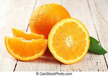 Orange fruit on white wooden background