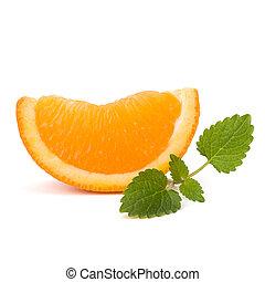 Orange fruit segment and citron mint leaf isolated on white background