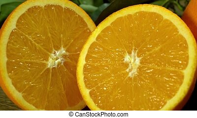 Orange cut in half. Camera moves from left to right.
