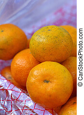 orange fruits on a basket  at the market