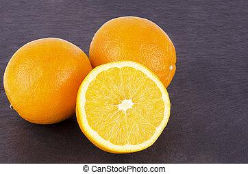 Orange fruits on slate