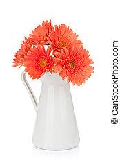 Orange gerbera flowers in pitcher