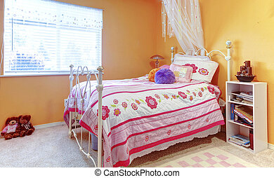 Orange girl teenager kids bedroom with toys, white bed frame and toys.