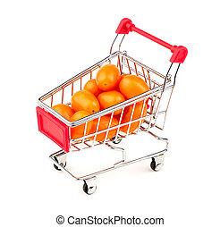 Orange gold grape tomatoes in mini shopping cart