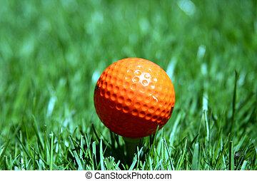 Orange golf ball