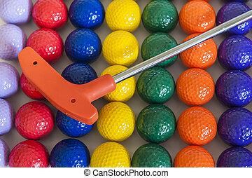 Orange Golf Club and Balls