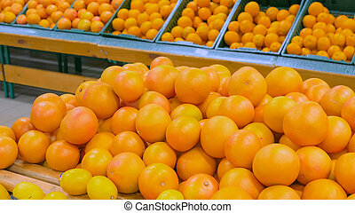 Orange grapefruits at grocery store