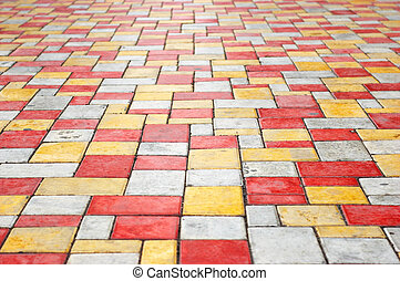orange, gray and yellow colored paving slab perspective background