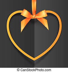 Orange heart shape frame hanging on silky ribbon with bow at black folded background