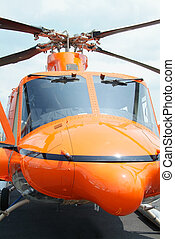 Orange helicopter - Close-up of orange rescue helicopter at...