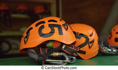 Orange helmets lie on the table