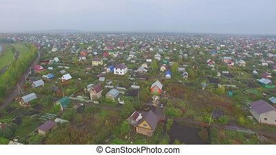 Orange house in a village. Aerial