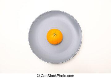 Orange in a dish on white background