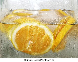 Orange Infused Water & slices Macro - a close up image of a...