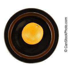 Orange Isolated on Black Serving Dish - Fresh ripe orange on...