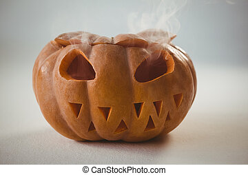 Orange jack o lantern on white background