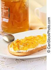 orange jam with toast on plate