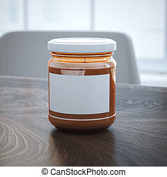 Orange jar with blank sticker on the table.