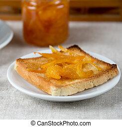 Orange jelly on the toasts