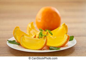 orange jelly orange slices on a plate