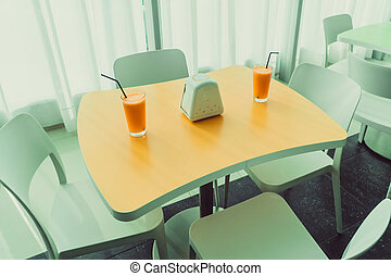 Orange juice. A glass of orange juice is on the table