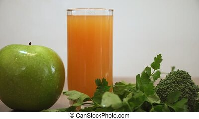 Orange juice, apple and green foods for healthy breakfast