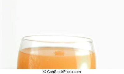 Orange juice drops falling in super slow motion