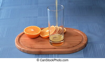 Orange juice. - Glass of juice and orange segment on a...