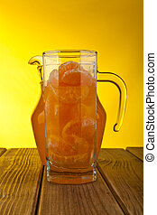 orange juice in a glass and a slice