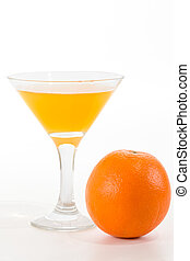 orange juice in a glass and orange on a white background