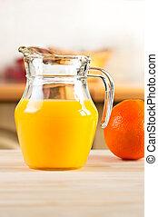 Orange juice in a glass jar