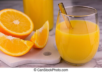 Orange juice in a glass on a white background. Close-up.