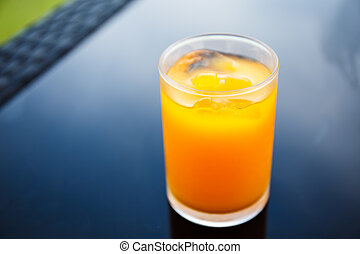 Orange juice in a glass on the table