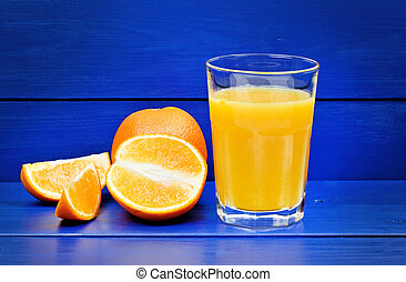 Orange juice in a glass on wooden table
