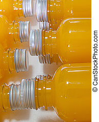 Orange juice in bottle.
