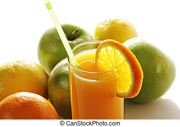 Orange juice in glass in front of fruits
